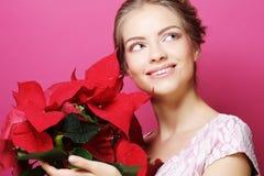 Frau mit Poinsettia Lizenzfreies Stockbild