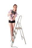 Frau mit Puncher auf Leiter Stockfotos