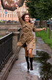Frau mit Regenschirm Stockbilder