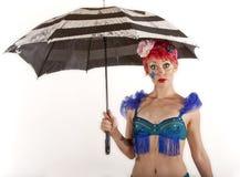 Frau mit Regenschirm Lizenzfreie Stockbilder
