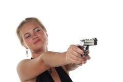 Frau mit Revolver Stockfoto