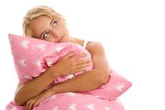 Frau mit rosafarbenem Kissen Lizenzfreies Stockfoto