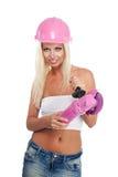 Frau mit rosafarbenem Winkelschleiferhilfsmittel Lizenzfreie Stockfotos