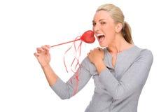 Frau mit rotem Innerem Lizenzfreie Stockbilder