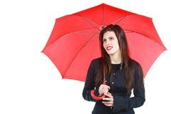Frau mit rotem Regenschirm Stockfotos