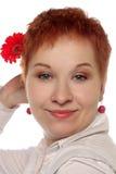 Frau mit roter Blume Stockbild