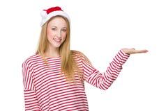 Frau mit Sankt-Hut und Hand stellen mit leerem Zeichen dar Lizenzfreies Stockfoto