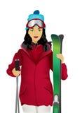 Frau mit Ski Stockfoto