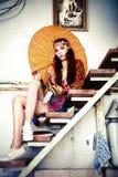 Frau mit Sonnenschirm Stockfotografie