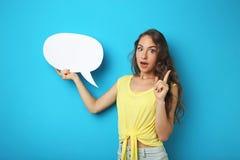 Frau mit Spracheluftblase Stockfotografie