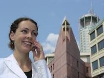 Frau mit Telefon Stockbild