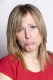 Frau mit traurigem Ausdruck Stockfotografie