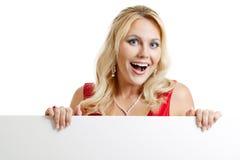 Frau mit unbelegtem Zeichen Lizenzfreie Stockbilder