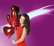 Frau mit Valentinsgruß baloons Lizenzfreies Stockfoto