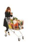 Frau mit vollem Warenkorbleseaufkleber Stockbild