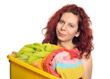 Frau mit Wäscherei Stockbild
