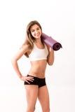 Frau mit Yogamatte Lizenzfreie Stockfotografie