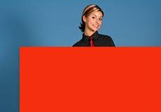 Frau mit Zeichen Lizenzfreie Stockfotografie