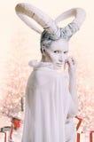 Frau mit Ziegenkörperkunst Stockbilder