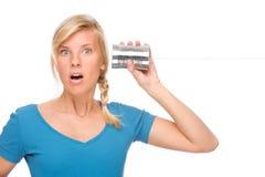 Frau mit Zinntelefon stockbilder