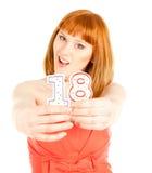 Frau mit zwei Kerzen auf dem weißen Hintergrund Lizenzfreies Stockbild