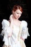 Frau oben gekleidet wie Aschenputtel Stockbild