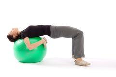 Frau Practing Pilates Stockfoto