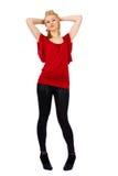 Frau in Rotem und in Schwarzem auf Weiß Stockfotografie