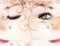 Frau? s-Gesicht mit einem Diamanten und Rollen Stockfotos