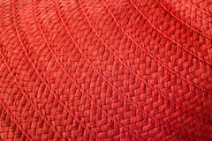 Frau ` s rote Strohhutbeschaffenheit Sommers Lizenzfreie Stockbilder