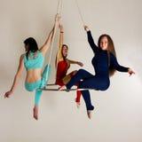 Frau ` s Trio auf Luftglanz Stockfoto