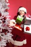 Frau Santa Claus With Christmas Tree Stockfotos
