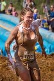 Frau schmutzig vom Rennen Stockfotos