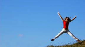 Frau springen stockfoto