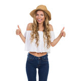 Frau in Straw Hat Showig Thumbs Up Stockfotos
