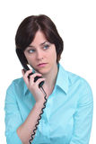 Frau am Telefon getrennt auf Weiß Stockbild