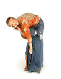 Frau am Telefon mit Koffer Lizenzfreie Stockbilder