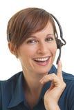 Frau Telemarketer mit der Hand auf Kopfhörer stockbilder