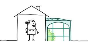 Frau u. Haus mit Veranda Stockbilder