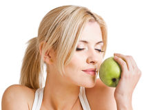 Frau und Apfel Lizenzfreie Stockbilder