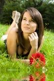 Frau und Blume lizenzfreies stockbild