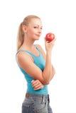 Frau und ein Apfel Lizenzfreie Stockbilder