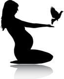 Frau und eine Taube Lizenzfreie Stockbilder