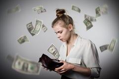 Frau und Geldbörse Dollar Stockfoto