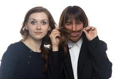 Frau und Mann, die ihr Haar schnüffeln Lizenzfreies Stockfoto