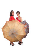 Frau und Regenschirme Stockbilder