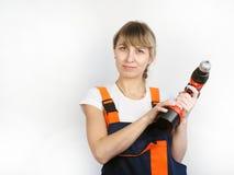 Frau und Reparatur Stockfotos