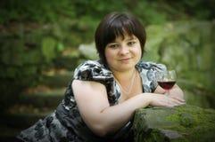 Frau und Rotwein 2 Stockfoto
