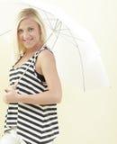 Frau unter einem Regenschirm Lizenzfreies Stockbild