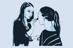 Frau visagist Maskenbildnerfarben auf dem Gesicht seines Kunden Lizenzfreie Stockbilder